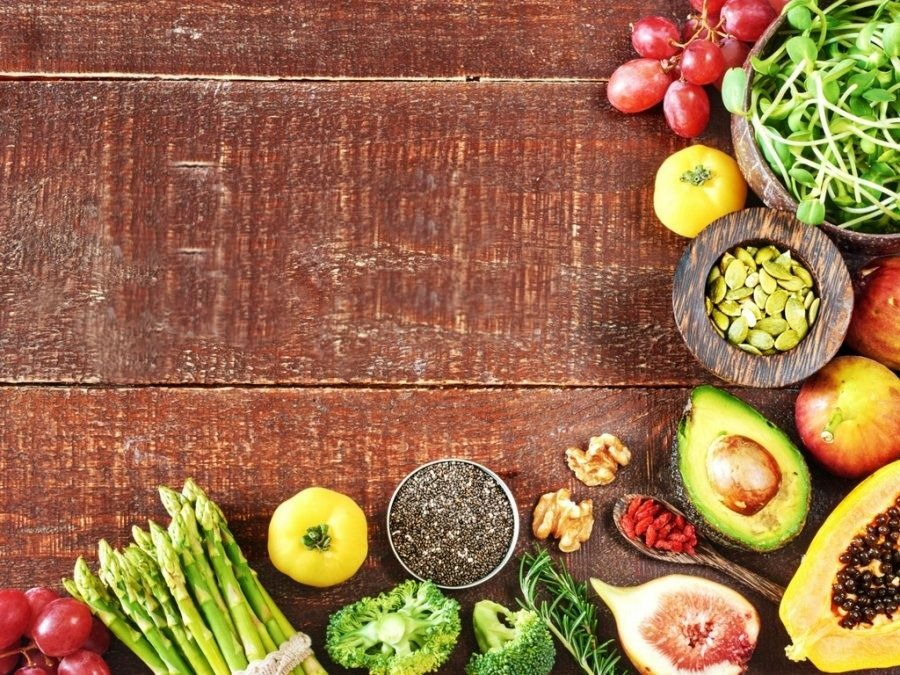 Fruits and vegetables on a wooden board.